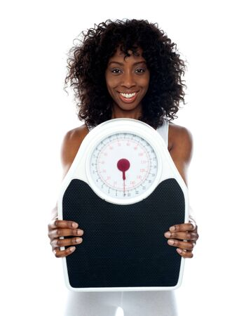 weight machine: African athlete showing weighing scale to camera. All on white background