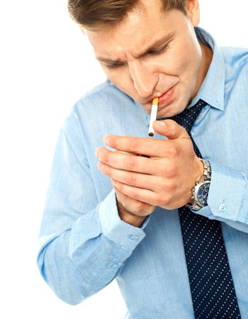 Portrait of handsome businessman with cigarette on white photo