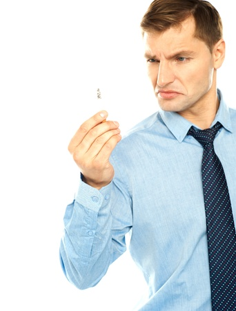 Angry smoker staring at cigarette isolated against white background photo