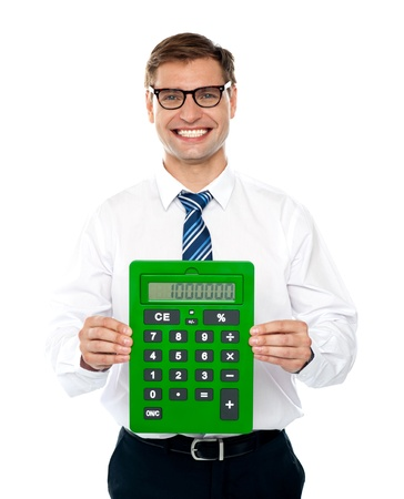 Male executive displaying green calculator isolated over white photo