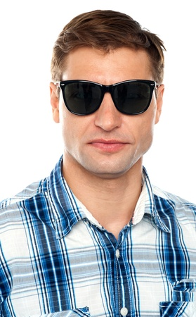 Closeup of handsome casual man wearing goggles. Isolated on white photo