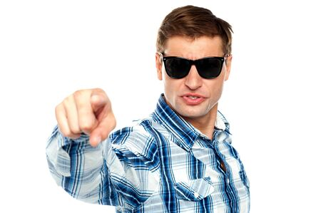 Cool fashionable guy pointing at you wearing sunglasses photo