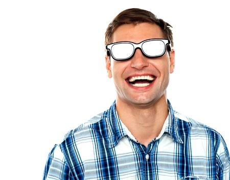 Young man enjoying himself after wearing shiny goggles photo
