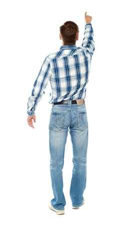 hands on pocket: Rear view of a male indicating towards copy space isolated over white background Stock Photo