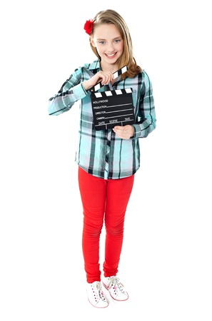 Little girl holding movie clapperboard. Get ready for some action photo