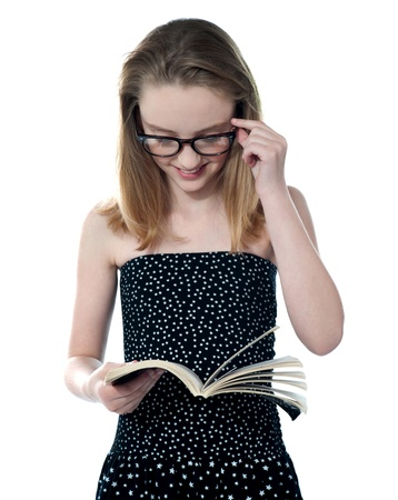 modern girl: Beautiful girl reading book and holding glasses Stock Photo
