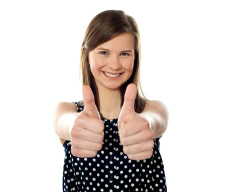 Close view of a pretty teenager showing double thumbs up photo