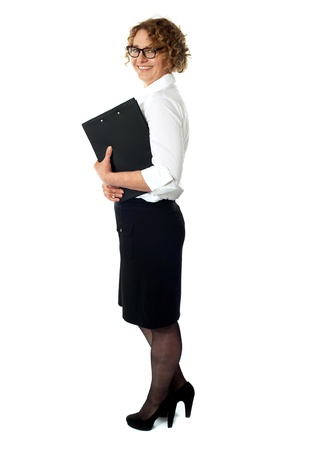 Full length portrait of a successful company manager holding clipboard photo