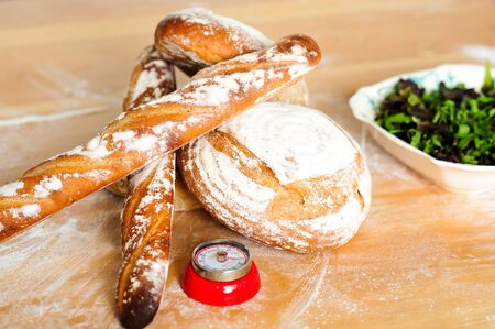 Closeup of baguettes and breads with green salad photo
