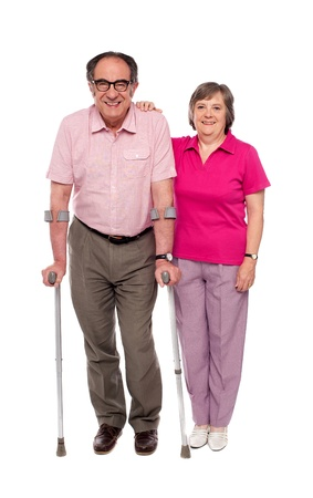 Woman supporting her handicapped husband isolated over white background photo