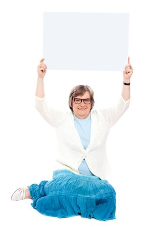 Seated representative holding blank white billboard over her head photo