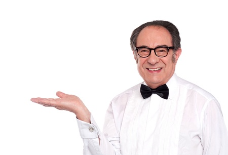 dinner wear: Elegant senior male representing copy space isolated against white background Stock Photo