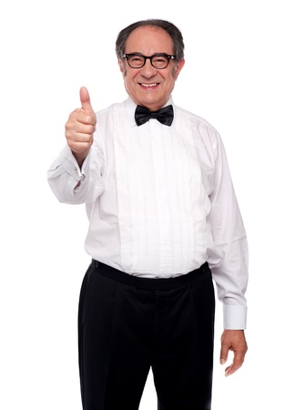 yup: Matured man showing thumbs up isolated over white background