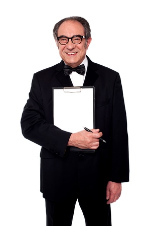 Stylish old man holding blank clipboard and pen. All on white background photo