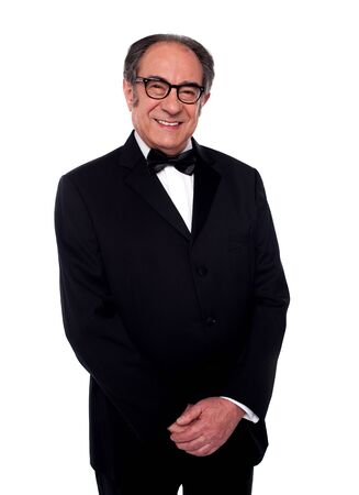 Well dressed smiling senior male posing with hand on hand against white background photo