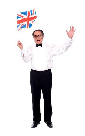 Stylish aged man celebrating success and waving British flag Stock Photo - 14301274
