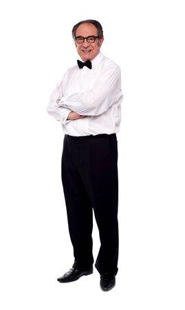 Elder man posing with arms crossed. Full length portrait Stock Photo - 14301275