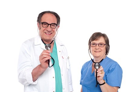 Smiling aged male and female doctors posing with stethoscope photo