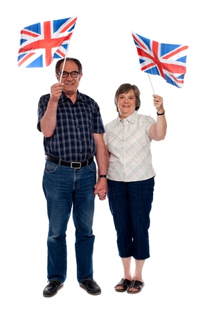 Senior citizens supporting their nation by holding flags photo