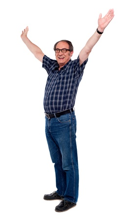 excited: Mature man standing with open arms against white