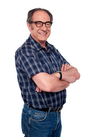 old man standing: Handsome senior male posing in style with arms crossed looking at camera Stock Photo