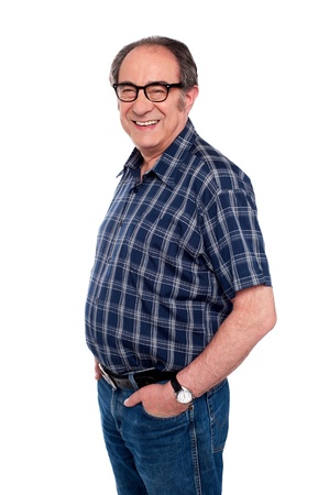 Man standing with hands in jeans pocket. Side view portrait photo