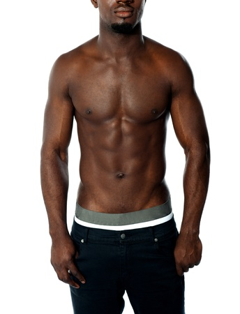 Cropped image of shirtless fit african guy isolated on white photo