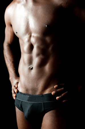 male arm: Shirtless underwear male model posing in style. Hands on waist, cropped image