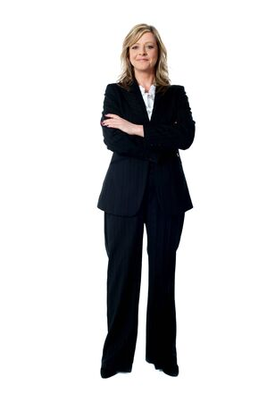 Portrait of glamorous corporate lady posing with arms crossed. Full length shot Stock Photo - 14382534