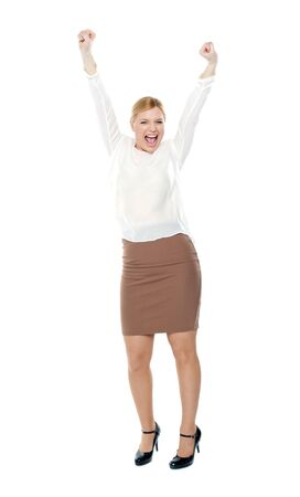 Beautiful blonde female enjoying success with both arms up Stock Photo - 14378622