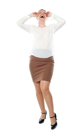 Pretty woman laughing loud. Full length shot. All on white background Stock Photo - 14382532