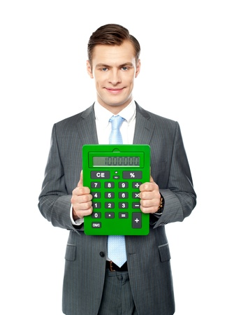 Corporate man showing big green calculator standing over white background Stock Photo - 14382681