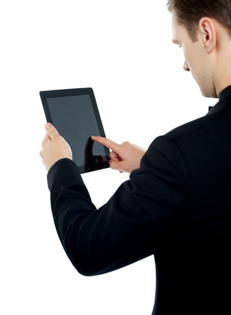 Man holding and pointing at screen of electronic digital frame photo