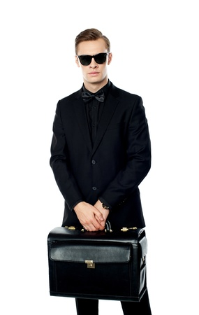 Young man carrying briefcase and wearing sunglasses photo