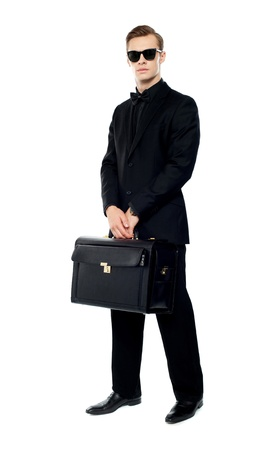 Full length portrait of handsome male with briefcase isolated over white background photo