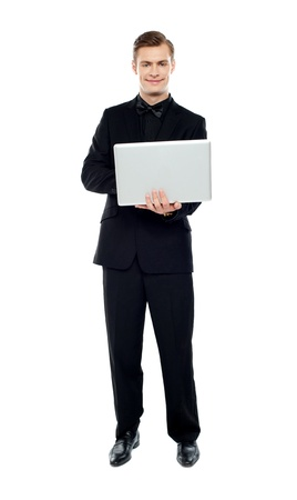 Smiling young man working on laptop against white background Stock Photo - 14382528