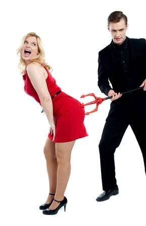Evil guy poking sensual woman in red. all on white background photo