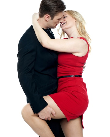 young couple hugging kissing: Sensual young couple making love. Man holding womans leg