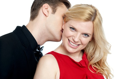 Closeup of young man kissing his lovers neck. All on white background photo