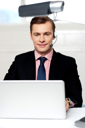 Portrait of handsome male operator wearing headset looking at camera Stock Photo - 14382591