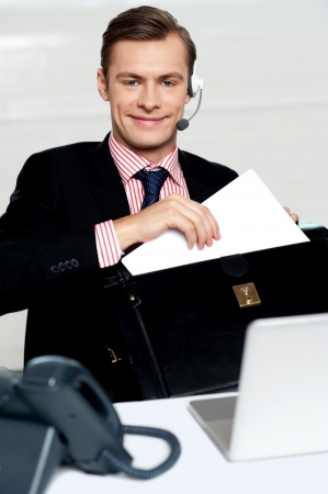 Customer care person arranging office documents. Sitting in office Stock Photo - 14382592