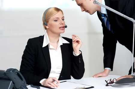 Female executive discussing business issue with her senior colleague photo