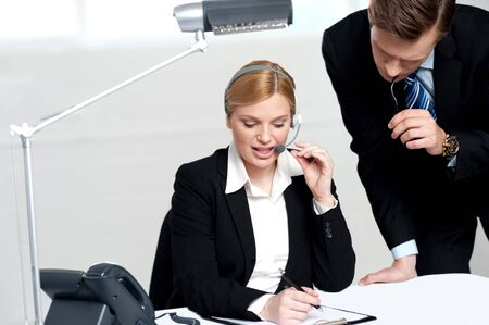 Woman discussing the problem with male colleague on papers document Stock Photo - 14396852