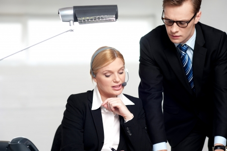 Female secretary explaining to boss in  the office photo