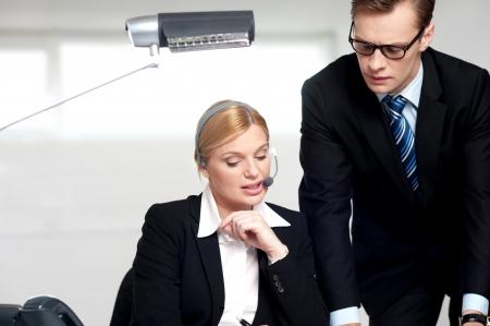 Female secretary explaining to boss in  the office photo