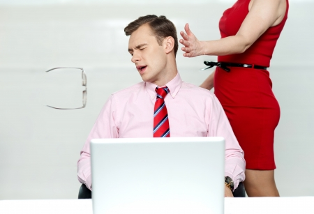 office wear: Woman slapping corporate male tightly for misbehaving with her Stock Photo