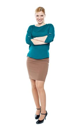 Full length portrait of trendy businesswoman posing with crossed arms Stock Photo - 14396809