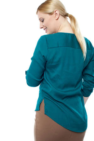 Portrait of beautiful young businesswoman, rear view Stock Photo - 14396880