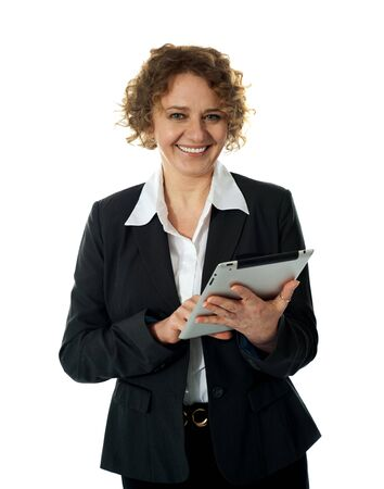 Aged businesswoman using touch screen device isolated over white background photo