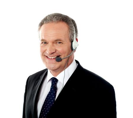 customer service representative: Customer service operator smiling wearing headphones with mic Stock Photo